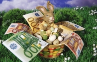 easter-bunny-sitting-in-a-basket-with-money-A2TF6N